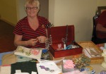 Norma with her stall at a members' bazaar