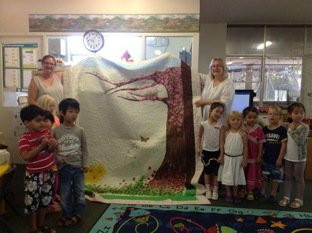 Megan Byrne, Mrs Forsburge and the Highgate Kindy children at the morning tea presentation