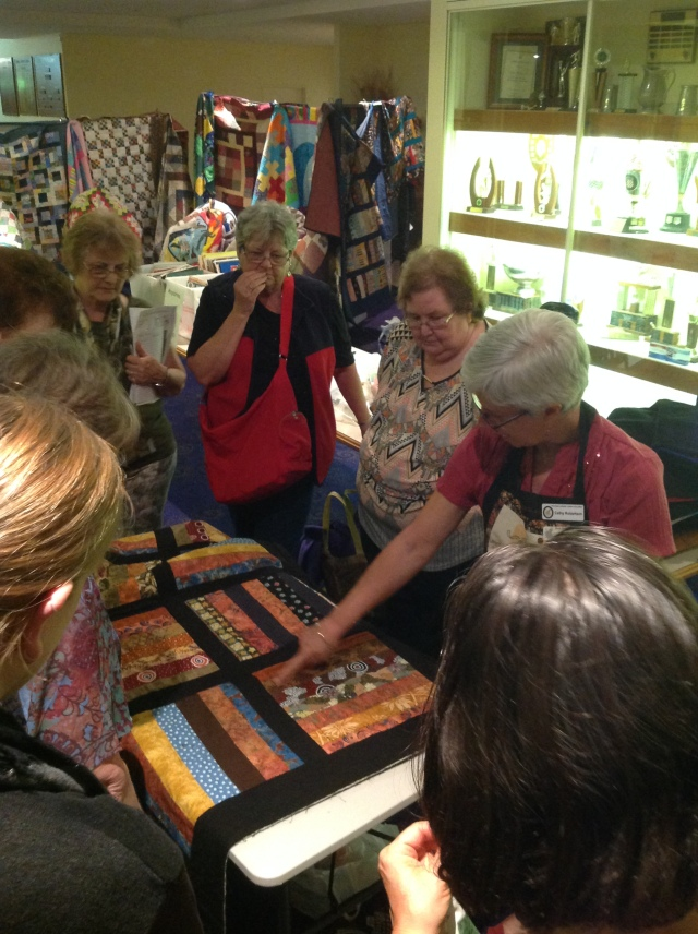 Cathy demonstrating ways to quilt your CQ